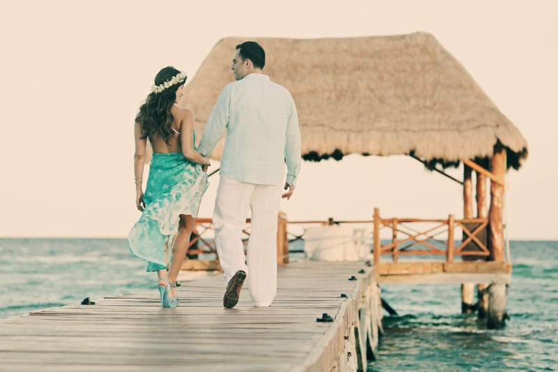 Engagement photo session of bride and groom walking on pier at Playa del Carmen, Mexico- Azul Fives Wedding photographers