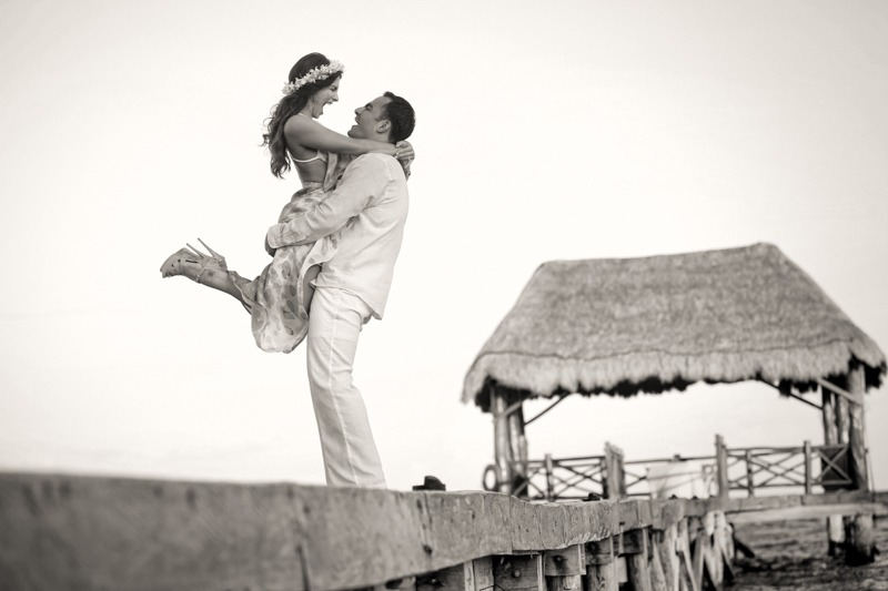 A (103) Groom lifting bride on pier on a  caribbean beach- Caribbean Beach wedding photographers