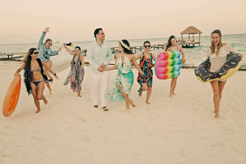 A (104) Bridesmaids and bride and groom running on white sand beach in Mexico- Azul Fives hotel wedding photographer