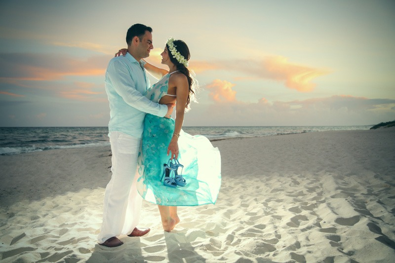 A (105) Engagement photo session of bride and groom on a white sand beach at sunset- Cancun wedding photographers