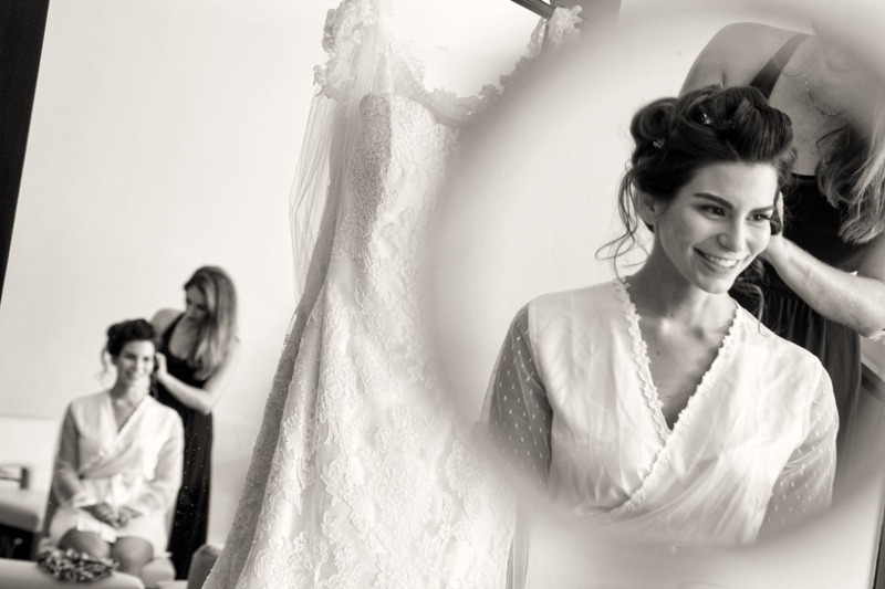 A (201) Bride reflected on mirror and wedding gown while getting ready- Wedding photographers in Mexican Riviera