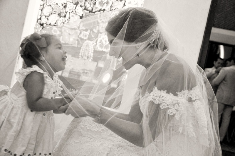 A (215) Bride and flower girl under veil- Cancun wedding photographers