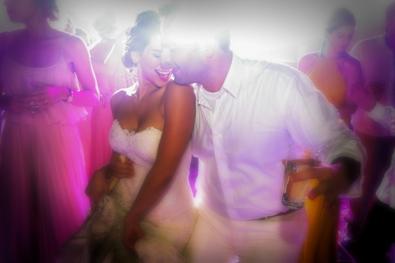 Bride and groom dancing at party in Xcaret Park - Cancun Mexico destination wedding photographers