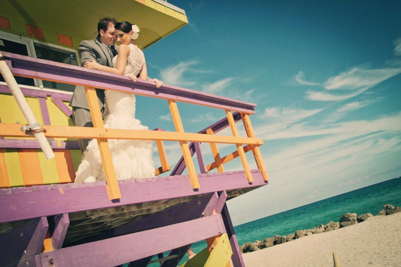 Bride and groom on lifeguard stand in Miami Beach- Jewish wedding photographers at The Palms Hotel