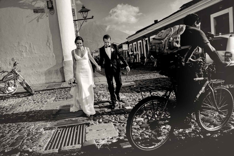 Bride and groom walking in the cobblestone streets of Antigua- Weddings in Antigua Guatemala