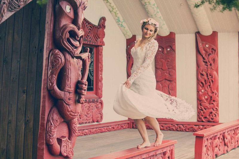 Bride dancing in Maori Marae in New Zealand- Wedding photographers in Auckland