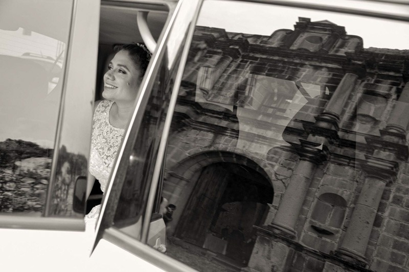 Bride in car with reflection of Capuchinas ruins- Capuchinas Antigua Guatemala wedding photographer