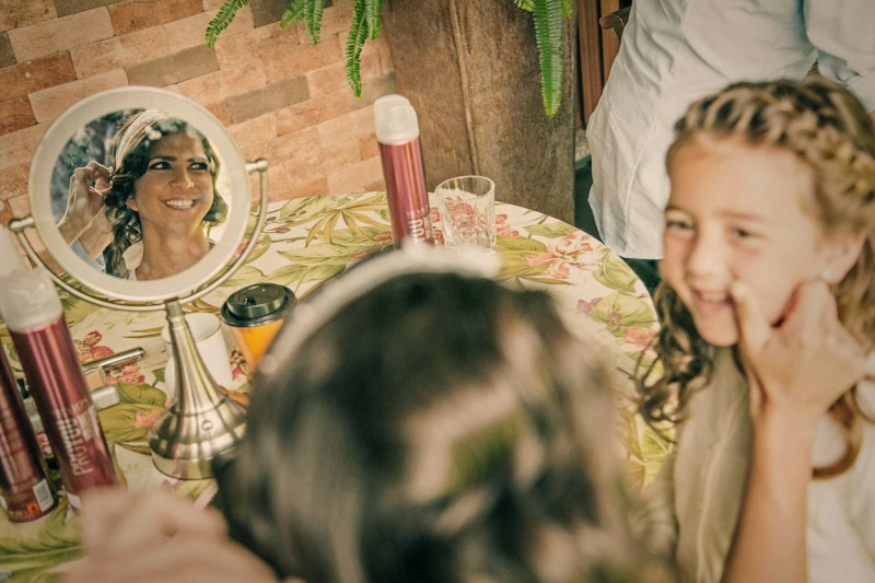 Bride reflected in mirror with flower girl- Wedding photographers in Guatemala