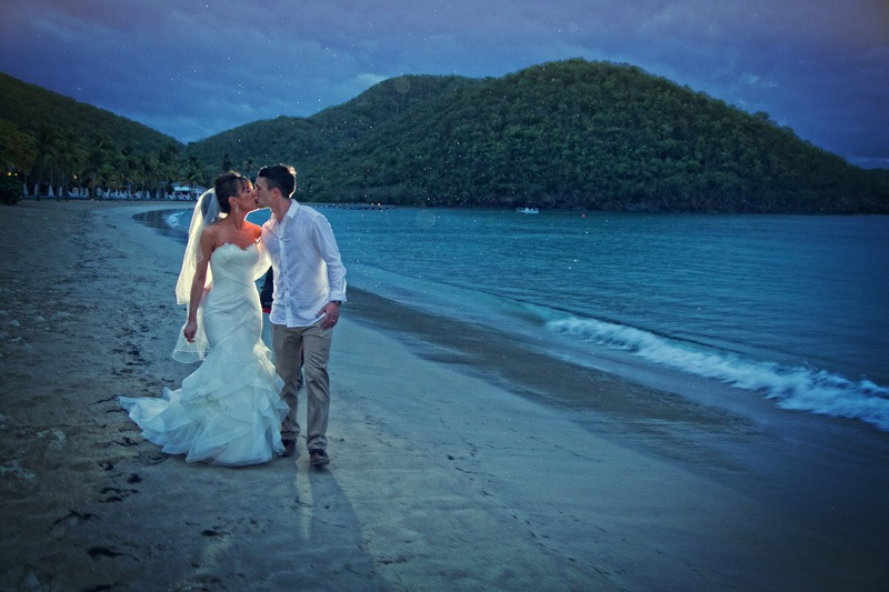 DC-1043 Night photo of bride and groom walking on a white sand beach in the caribbean - Carlisle Bay wedding photography