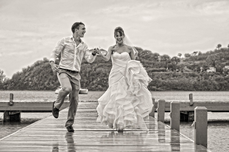 DC-1056 Bride and groom running on dock at Carlisle Bay Hotel- wedding photographers Carlisle Bay