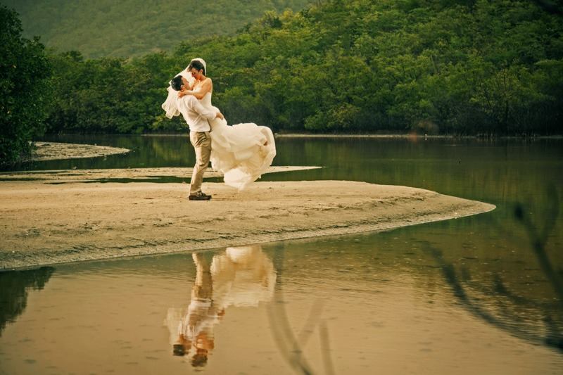 DC-1059 Groom lifting bride in a marsh of Carlisle Bay in the island of Antigua - Caribbean beach wedding photography