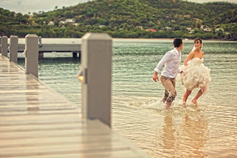 DC-1062 Bride and groom running in water at Carlisle Bay beach - Antigua and Barbuda weddings