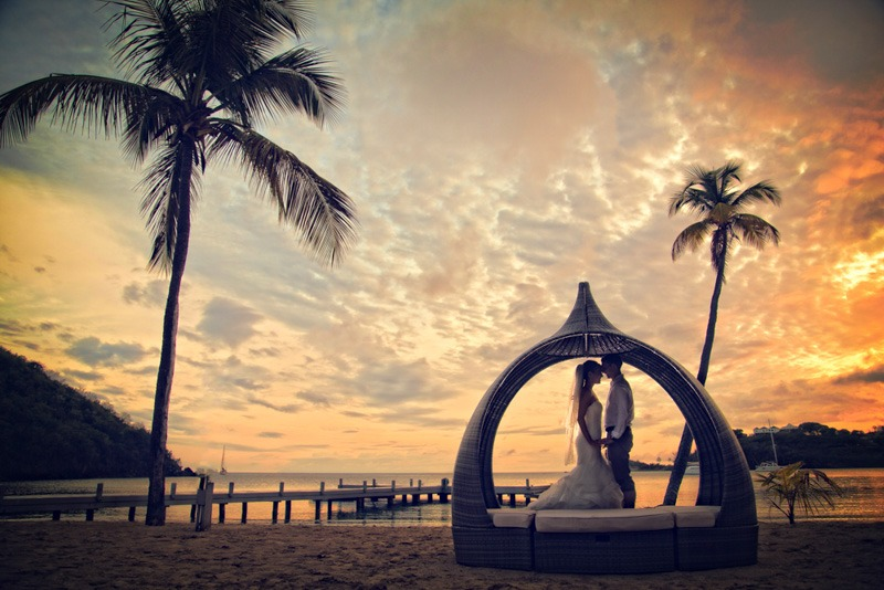 DC-1063W  Bride and groom with palm trees and a beautiful caribbean sunset - Caribbean island wedding photographer