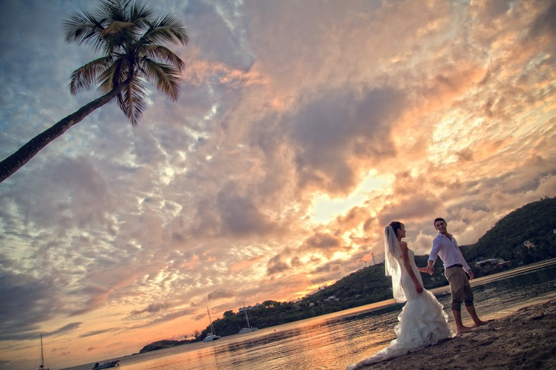DC-1064 Bride and groom walking on the beach at Carlisle Bay in the sunset - Antigua and Barbuda wedding photos