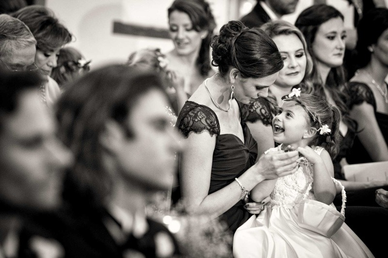 Flower girl smiling during wedding ceremony-Antigua Guatemala wedding photographers
