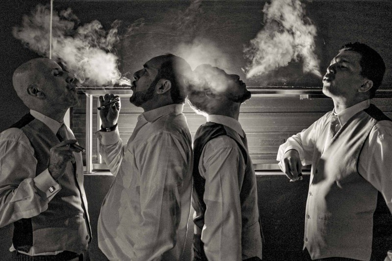 Groom and groomsmen smoking cigars-Antigua Guatemala wedding photographers