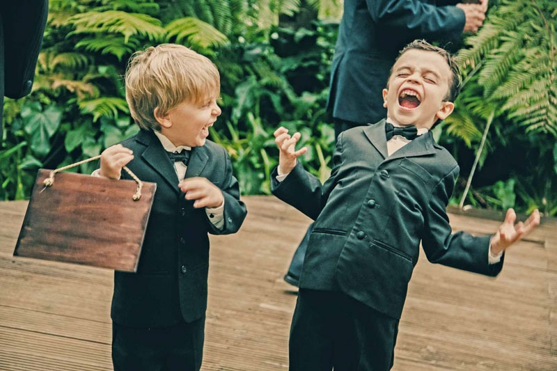 Ring bearer kids laughing at wedding in San Bernardo- wedding photographers in Guatemala
