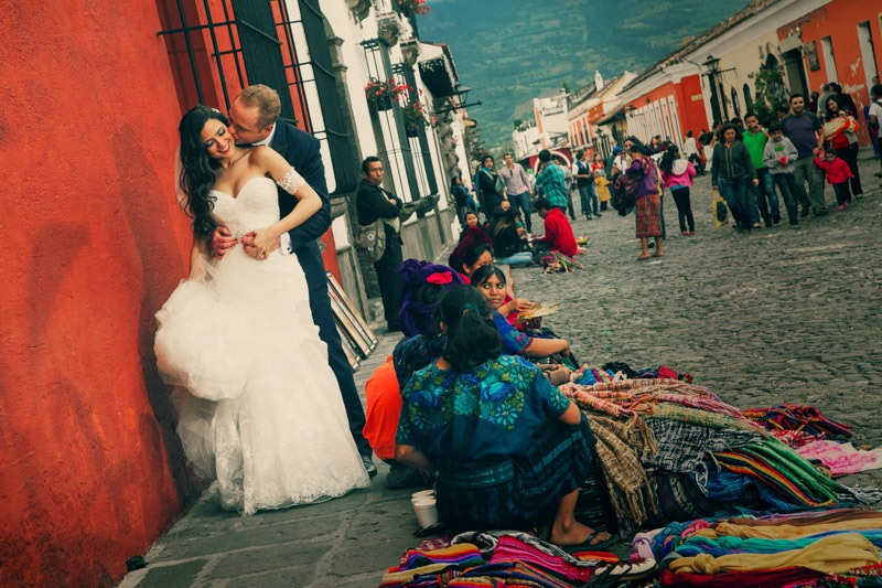 TC-1138 Bride and groom and native Mayan street sellers - Destination wedding in Antigua Guatemala