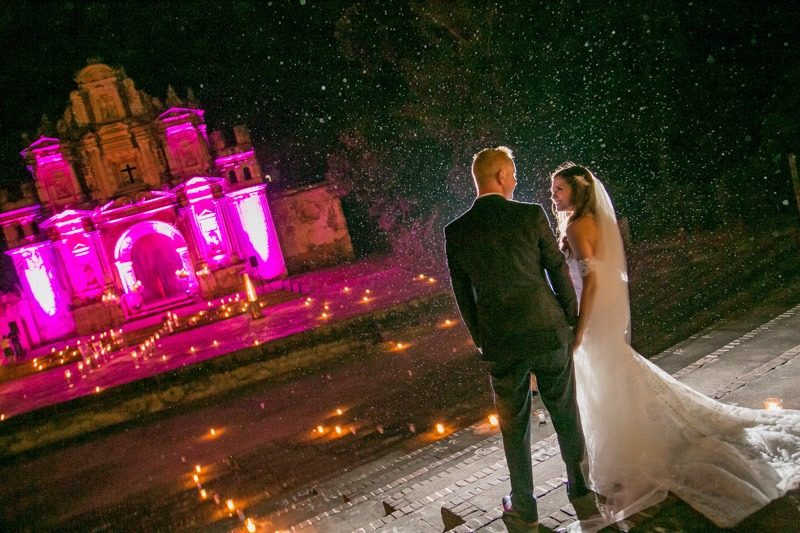 TC-1262  Night photo of bride and groom walking to La Ermita de la Santa Cruz- Antigua Guatemala wedding photographers