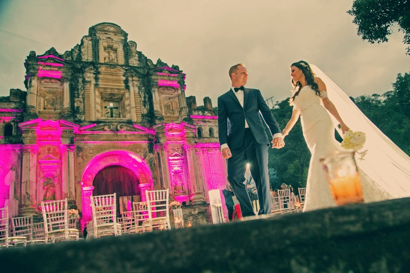 TC-1283 Bride and groom walking in front of Colonial ruin in Antigua Guatemala - Wed in Guatemala