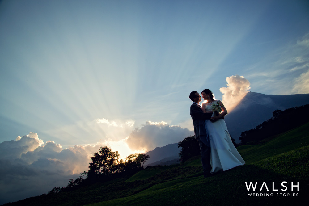 Bride and groom with volcano and sunset at la reunion golf