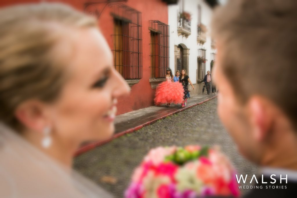 antigua guatemala weddings-bride and groom spotting a quinceañera in antigua
