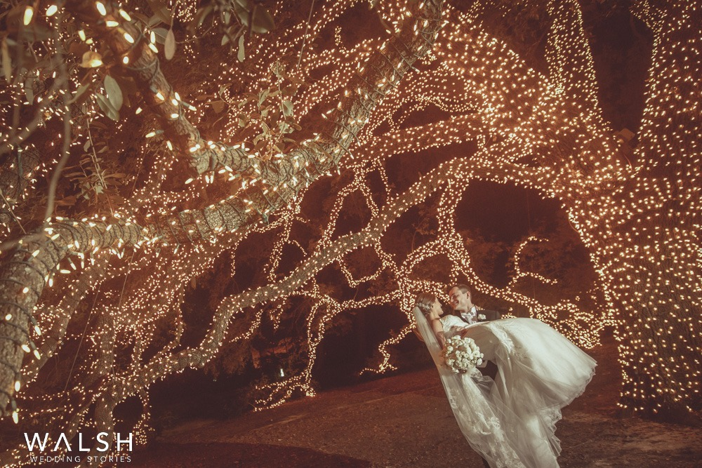 night photo of bride and groom under tree at the houstonian hotel