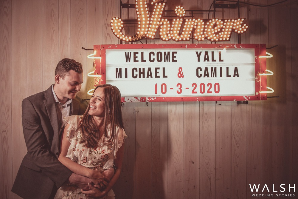 bride and groom with sign Houston wedding photographers